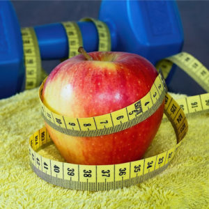 Weight loss apple image by Schlachta Stanislav (via Shutterstock).